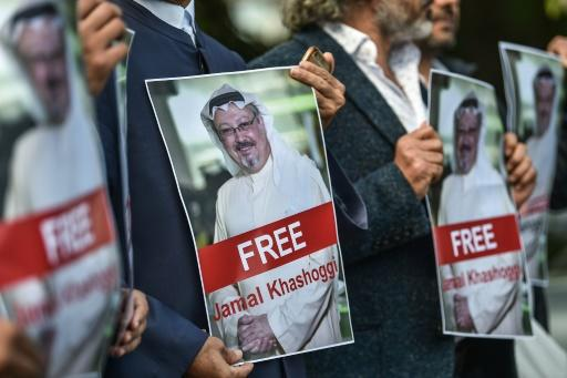 Protestors hold pictures of journalist Jamal Khashoggi during a demonstration in front of the Saudi Arabian consulate in Istanbul on October 5, 2018