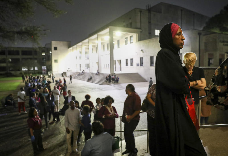 """I can remember when I did not have the right to vote,"" said Nancy Glenn Griesinger, second from right, when asked why she waited so long in line to vote Tuesday, March 3, 2020, at Texas Southern University in Houston. After 10 p.m., a line of people still stretched out of the Robert James Terry Library as they waited to cast their votes. (Jon Shapley/Houston Chronicle via AP)"