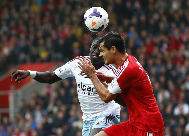 Southampton's Lovren tackles West Ham's Demel during their English Premier League soccer match in Southampton, southern England