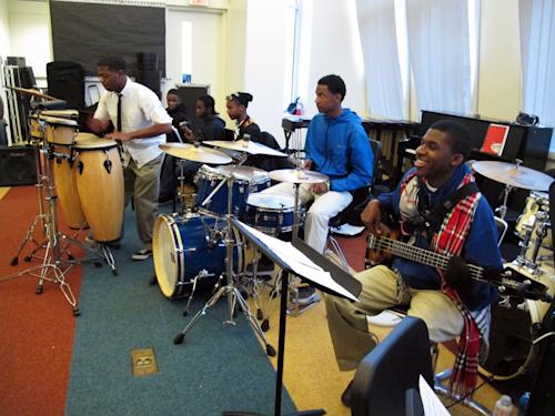 "In this March 22, 2013 photo, Bongo player Brandon Chornes, from left, drummer David Pruitt and bass guitar player David McKenzie rehearse a song at Stax Music Academy in Memphis, Tenn. The Stax Music Academy is an after-school program where teenagers from some of Memphis' poorest neighborhoods learn how to dance, sing and play instruments. The academy's students play annual shows in Memphis and have toured to Washington, Italy and Australia, helping spread the soulful ""Memphis Sound."" (AP Photos/Adrian Sainz)"