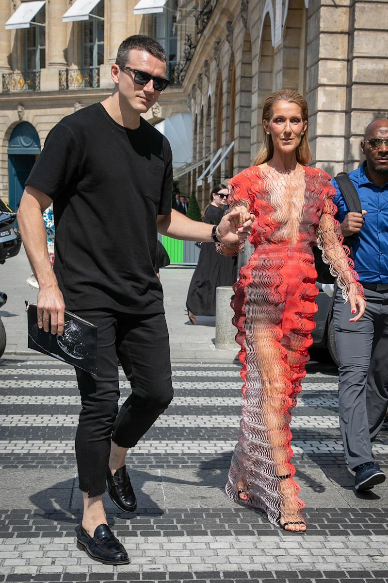 Pepe Munoz holds Celine Dion'd hand as she walks across the road.