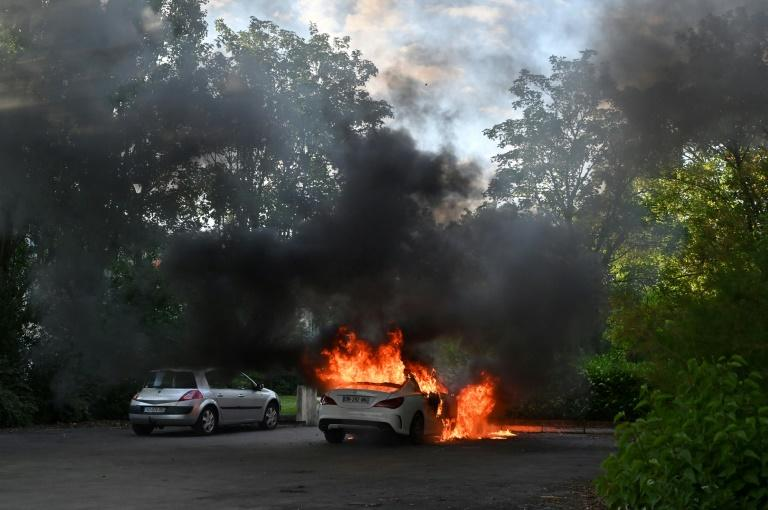At least 20 people were injured and several cars burned during the unrest