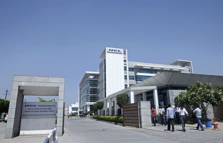People walk in front of the HCL Technologies Ltd office at Noida, on the outskirts of New Delhi April 17, 2013. REUTERS/Mansi Thapliyal/File Photo