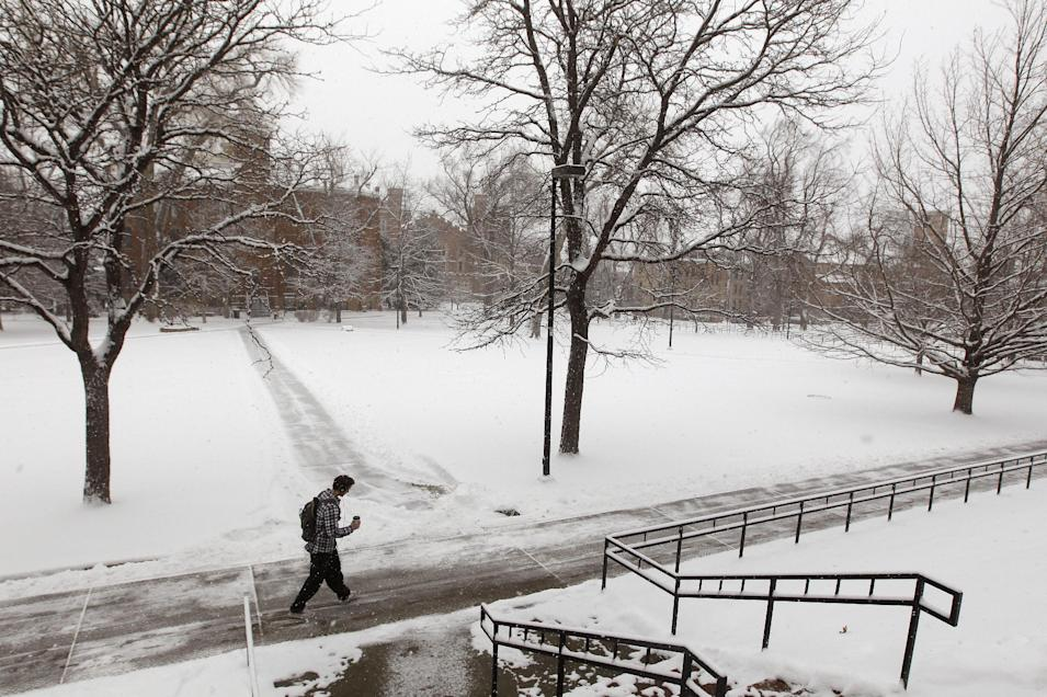 A student walks on the campus of the Univerisity of Colorado as a blizzard dropped snow over Boulder, Colo., Wednesday Dec. 19, 2012. A storm that has dumped more than a foot of snow in the Rocky Mountains is heading east and is forecast to bring the first major winter storm of the season to the central plains and Midwest. (AP Photo/Brennan Linsley)