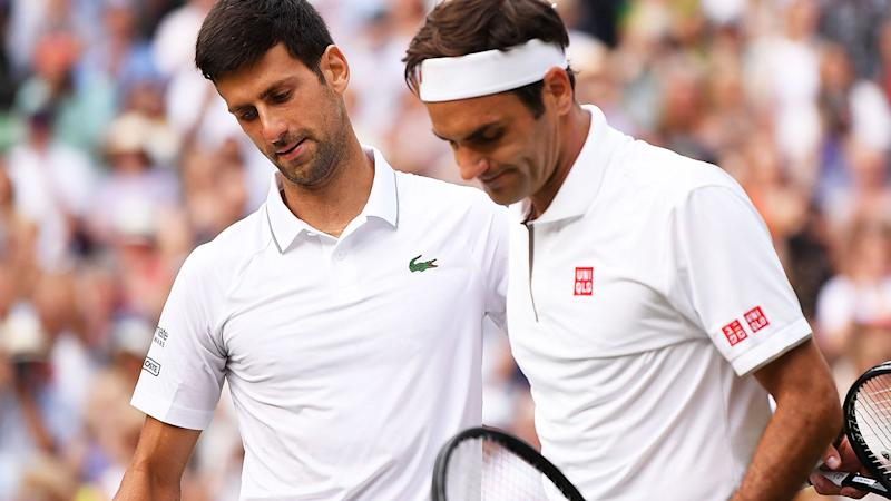 Novak Djokovic and Roger Federer embrace after their epic Wimbledon final. (Photo by LAURENCE GRIFFITHS/AFP/Getty Images)