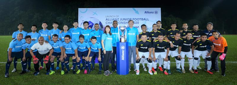 Team Allianz Malaysia FC and Team Media FC pose for a commemorative picture before their friendly. — Picture courtesy of Allianz Malaysia Berhad