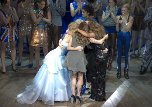 Mel B, Geri Halliwell, Emma Bunton, Victoria Beckham and Mel C hug on stage at the curtain call for Viva Forever! Press Night, a musical based on the songs of the Spice Girls, at the Piccadilly Theatre in central London, Tuesday, Dec. 11, 2012. (Photo by Joel Ryan/Invision/AP)