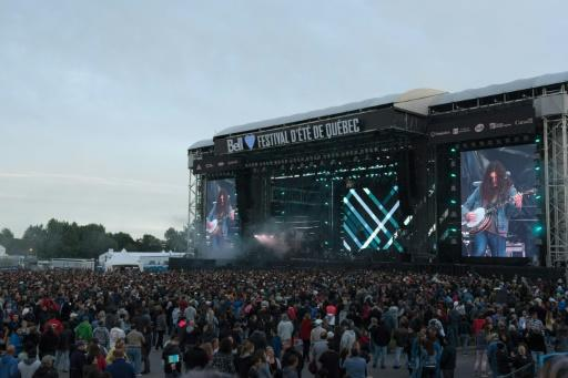 The crowd at Quebec's Festival d'ete de Quebec watching rocker Kurt Vile on the huge stage in the Plains of Abraham park