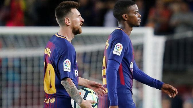 Lionel Messi dan Nelson Semedo (AFP/Pau Barrena)