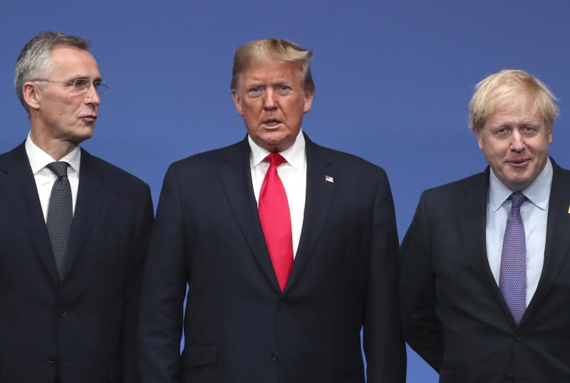 NATO Secretary General Jens Stoltenberg, left, and British Prime Minister Boris Johnson, right, welcome U.S. President Donald Trump during a NATO leaders meeting at The Grove hotel and resort in Watford, Hertfordshire, England, Wednesday, Dec. 4, 2019. NATO Secretary-General Jens Stoltenberg rejected Wednesday French criticism that the military alliance is suffering from brain death, and insisted that the organization is adapting to modern challenges. (AP Photo/Francisco Seco)