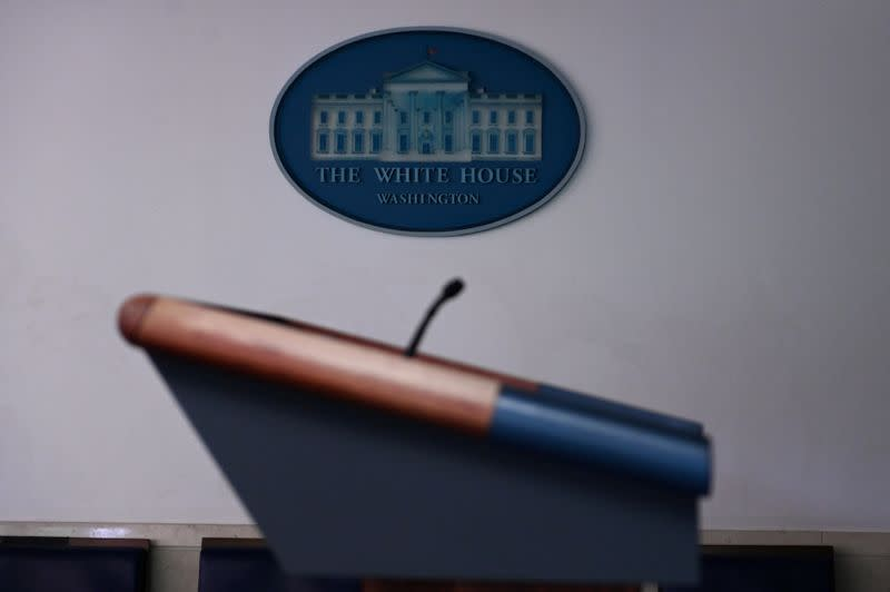 FILE PHOTO: The White House briefing room podium is dark and empty after the coronavirus task force did not hold a briefing for the second day in a row in Washington