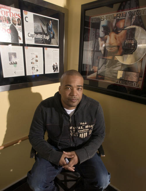 FILE - This Feb. 28, 2007 file photo shows hip-hop mogul Chris Lighty in his office in New York. Lightly died of an apparent gunshot wound on Thursday, Aug. 30, 2012 at his home in the Bronx borough of New York. He was 44. Lighty was the man behind rap's leading figures, helping them not only attain hit records, but lucrative careers outside of music. He had been a part of the rap scene for decades, working with pioneers like LL Cool J, KRS-One before starting his own management company, Violator. (AP Photo/Jim Cooper, file)