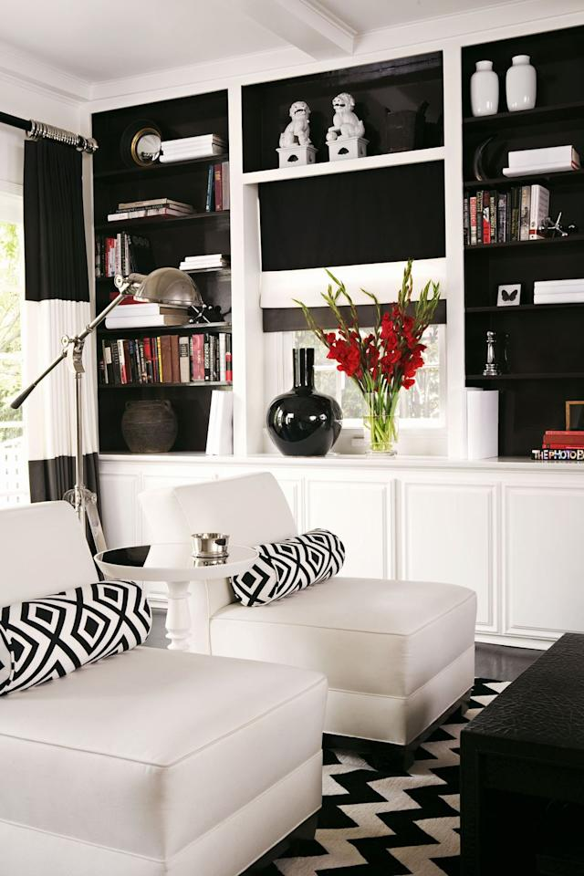 <p>Thanks to a timeless black-and-white color combo, there's no shortage of panache in this interior.</p>