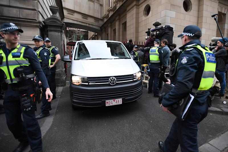 Cardinal Pell arrives under heavy police guard at the Supreme Court. Source: AAP