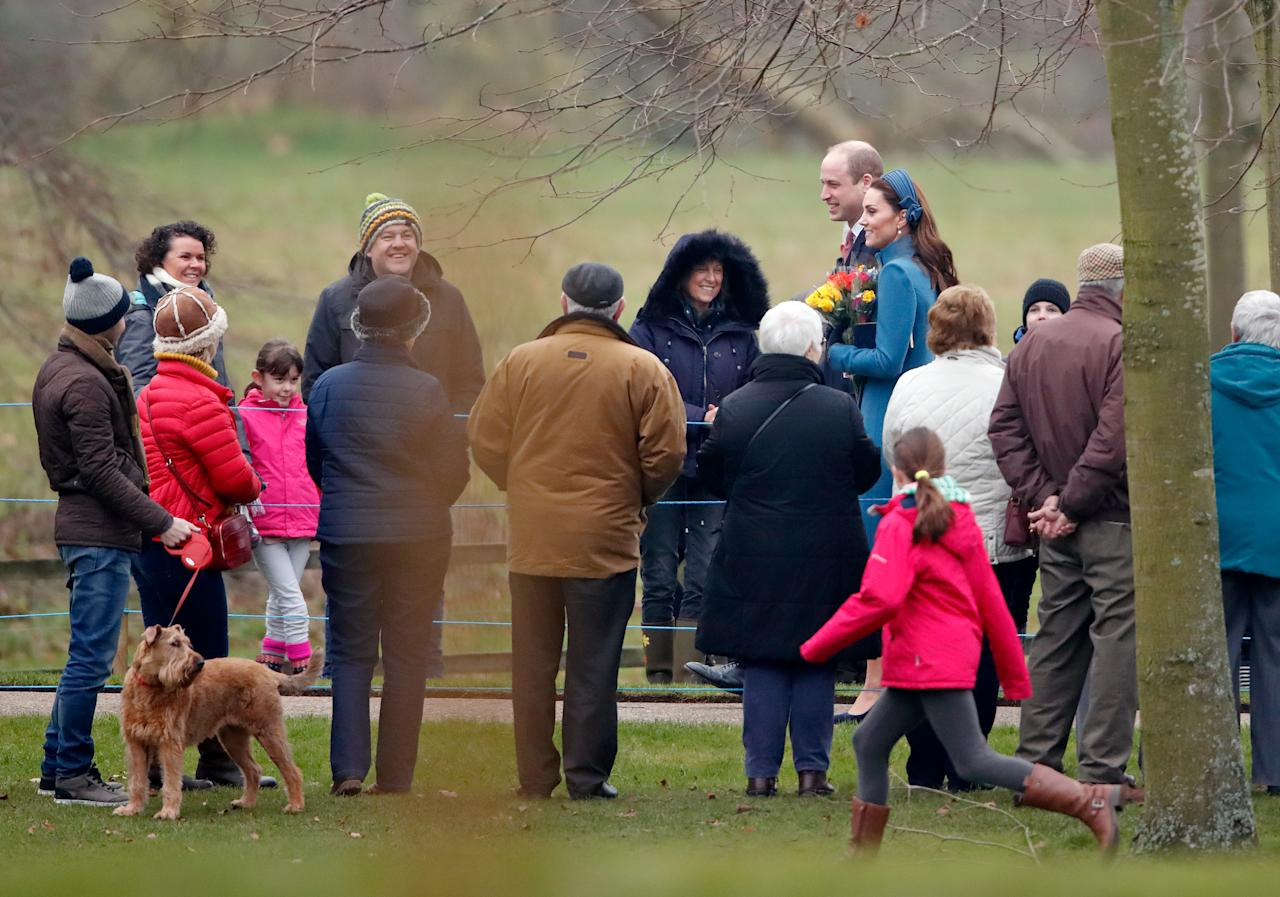 <p>William and Kate were all smiles as they stopped to greet some fans on the way to the service. Photo: Getty </p>