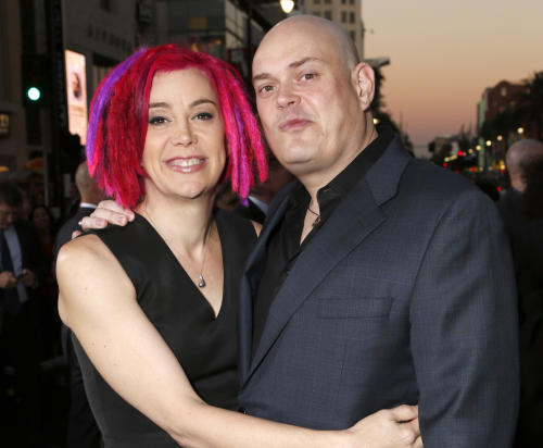 "FILE - In this Oct. 24, 2012, file photo, co-directors Lana Wachowski and Andy Wachowski pose for a photo at the Los Angeles premiere of ""Cloud Atlas"" in Los Angeles. The Wachowski siblings say they're hoping to again surprise audiences with the science-fiction movie ""Jupiter Ascending,"" starring Channing Tatum and Mila Kunis. The Wachowskis said in an interview Thursday, Oct. 24, 2013, that they were overseeing editing and special effects for the movie set for release next summer. (Photo by Todd Williamson/Invision, File)"