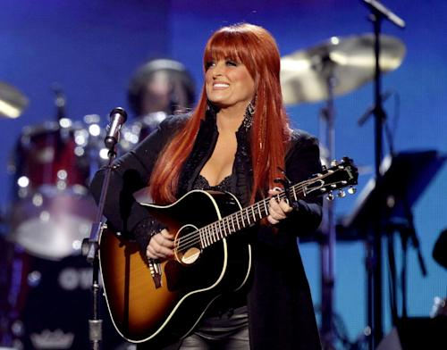"""FILE - This April 4, 2011 file photo shows country singer Wynonna Judd from The Judds, performing at the Girls' Night Out: Superstar Women of Country in Las Vegas. Judd is one of eleven celebrity contestants who will compete on the next edition of """"Dancing with the Stars."""" The new season kicks off on ABC with a two-hour premiere on March 18. (AP Photo/Julie Jacobson, file)"""