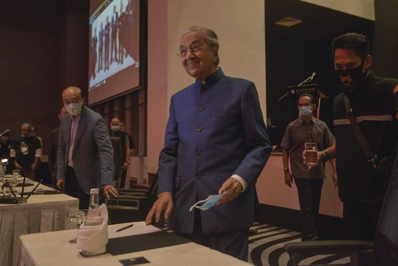Datuk Seri Mukhriz Mahathir (left) and Tun Dr Mahathir Mohamad arrive for a media conference at the Pullman Kuala Lumpur in Bangsar August 7, 2020. — Picture by Shafwan Zaidon
