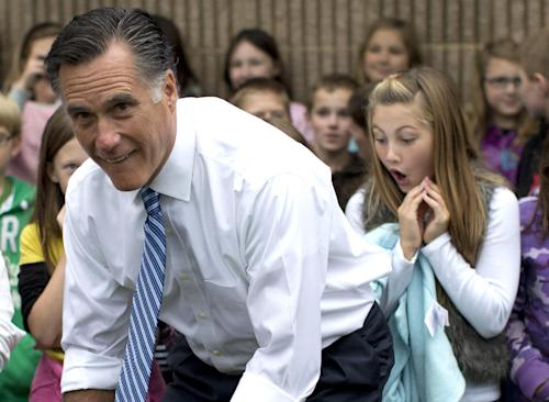 Republican presidential candidate, former Massachusetts Gov. Mitt Romney poses for photographs with students of Fairfield Elementary School, Monday, Oct. 8, 2012, in Fairfield, Va. (AP Photo/ Evan Vucci)