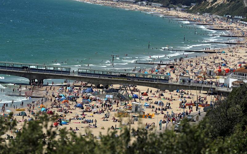 People on the beach at Bournemouth as the hot weather continues - Steve Parsons/PA