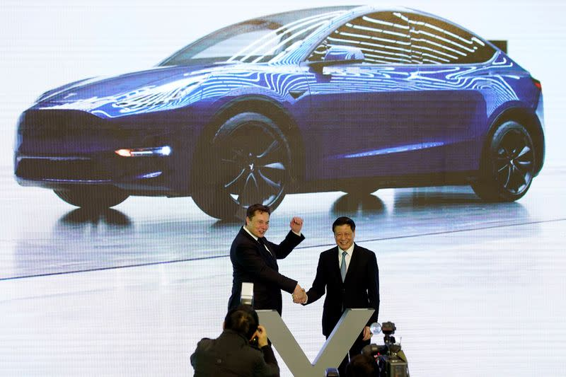 Tesla Inc CEO Elon Musk and Shanghai's Mayor Ying Yong attend an opening ceremony for Tesla China-made Model Y program in Shanghai