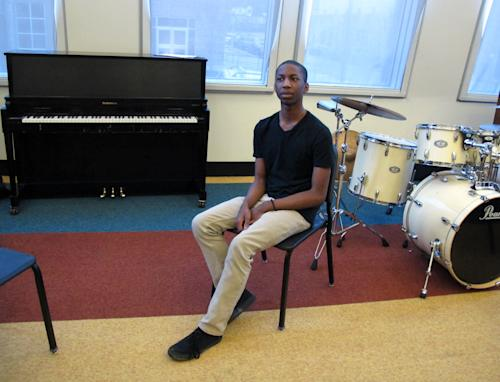 "In this March 22, 2013 photo, Adrian Williams, 18, talks about his experience at Stax Music Academy, where he has honed his singing and dancing abilities for four years, in Memphis, Tenn. The Stax Music Academy is an after-school program where teenagers from some of Memphis' poorest neighborhoods learn how to dance, sing and play instruments. The academy's students play annual shows in Memphis and have toured to Washington, Italy and Australia, helping spread the soulful ""Memphis Sound."" (AP Photos/Adrian Sainz)"
