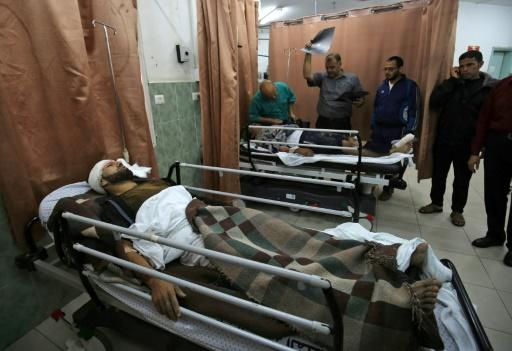 Wounded Palestinians receive treatment in Najjar hospital in Rafah after Israel conducted some 20 air strikes on the Gaza Strip on October 17, 2018
