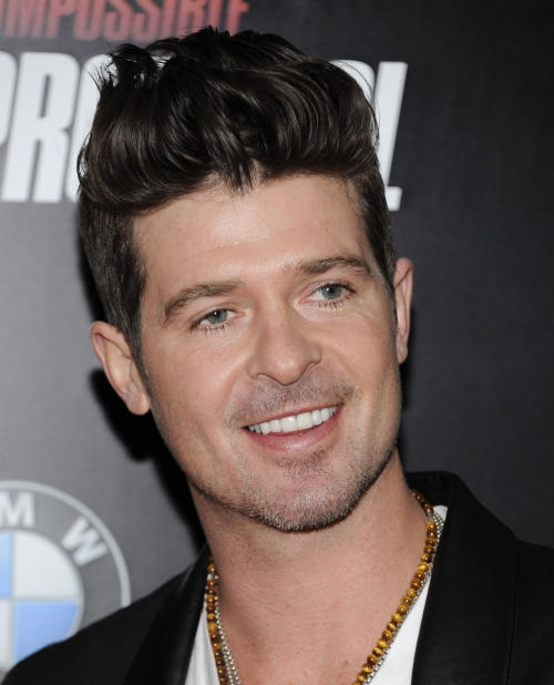 "FILE - In this Dec. 19, 2011 file photo, singer Robin Thicke attends the U.S. premiere of ""Mission: Impossible - Ghost Protocol"" at the Ziegfeld Theatre in New York. Thicke has been arrested on a drug possession charge Friday afternoon in Manhattan near Madison Square Park. Police say they saw him smoking a joint while inside a black SUV. He was given a desk appearance ticket and released. (AP Photo/Evan Agostini, file)"