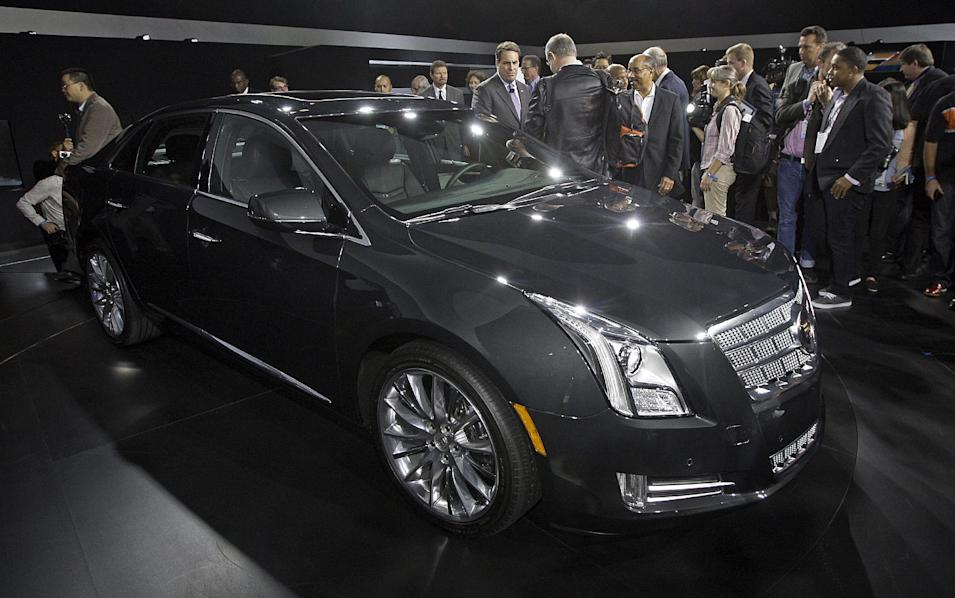 The Cadillac XTS is seen during its debut at the Los Angeles Auto Show Wednesday, Nov. 16, 2011. General Motors Co.'s luxury brand unveils the replacement for its old land yachts, the DTS and STS. The company promises space and elegance with technology for a new generation of buyers. (AP Photo/Reed Saxon)