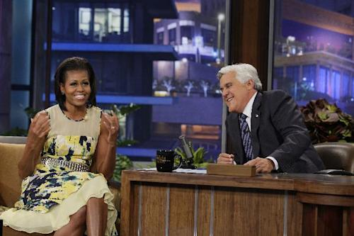 """This Monday, Aug. 13, 2012 photo released by NBC shows first lady Michelle Obama, left, and host Jay Leno during a taping of """"The Tonight Show with Jay Leno,"""" in Burbank, Calif. (AP Photo/NBC, Margaret Norton)"""