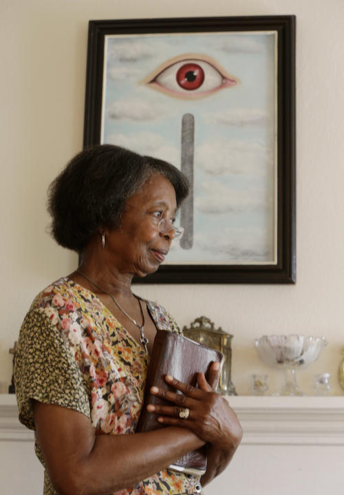 Henrietta Tripp stands in her home in Birmingham, Ala., Friday, Sept. 6, 2013. Following her retirement, Tripp, who is ordained, started a youth drug ministry. (AP Photo/Dave Martin)