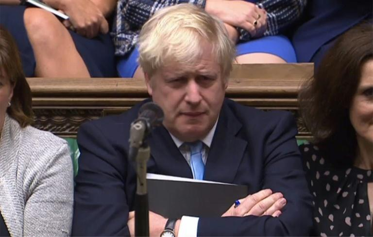 the detention of two British-Australian nationals, if confirmed, would present a further challenge to embattled British Prime Minister Boris Johnson