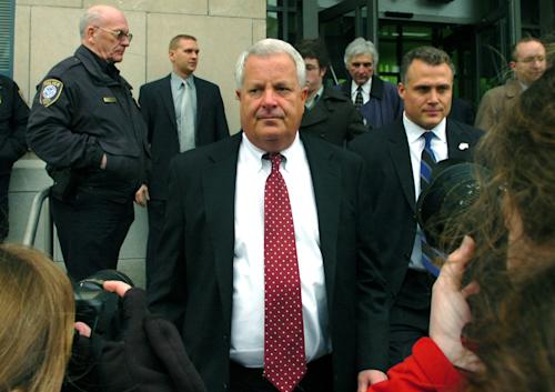 "FILE - In this Feb. 12, 2009 file photo, Michael Conahan, center, leaves the federal courthouse in Scranton, Pa. The film ""Kids for Cash"" set to open explores the scandal that entangled thousands of children in Pennsylvania's juvenile court system and sent two former judges to prison. Mark Ciavarella is serving a 28-year sentence and fellow ex-judge Conahan is serving 17 years for taking $2.6 million from companies looking to build and fill a youth detention center for Luzerne County. (AP Photo/David Kidwell, File)"