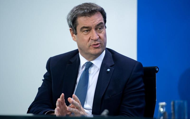 Bavarian Prime Minister Markus Soeder attends a news conference after discussing with German state premiers on whether to prolong or phase-out the lockdown to combat COVID-19 at the Chancellery in Berlin, Germany, April 15, 2020, as the spread of the coronavirus disease (COVID-19) continues in Munich. Bernd von Jutrczenka/Pool via REUTERS - POOL/via REUTERS
