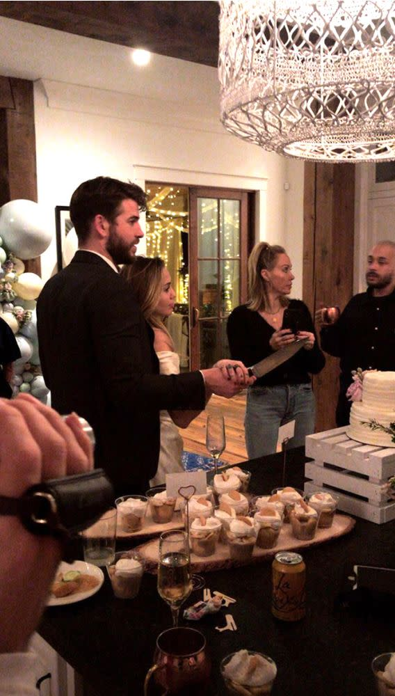 Liam Hemsworth and Miley Cyrus, with the singer's mom Tish, at a possible wedding celebration