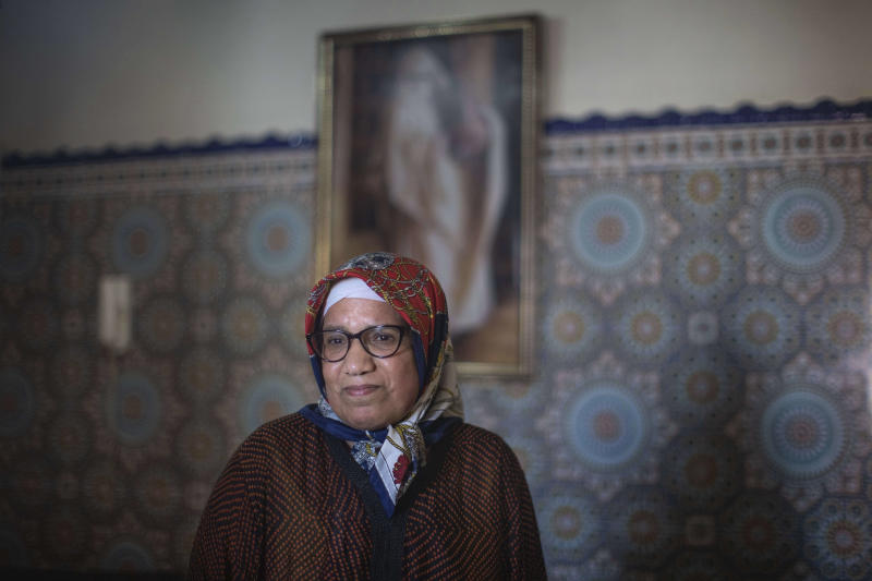 Ghita Naoui is seen inside her home as she spends Eid in lockdown with her family members due to the Coronavirus pandemic, in Sale, Morocco, Sunday, May 24, 2020. Instead of mass prayers and large family gatherings filled with colorful clothes, gifts, and traditional foods, millions of Moroccan Muslims celebrated Eid Al-Fitr at home, subdued and isolated amid their country's newly extended coronavirus lockdown. (AP Photo/Mosa'ab Elshamy)
