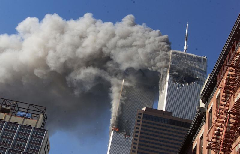 Smoke rises from the burning twin towers of the World Trade Center after hijacked planes crashed on September 11, 2001.