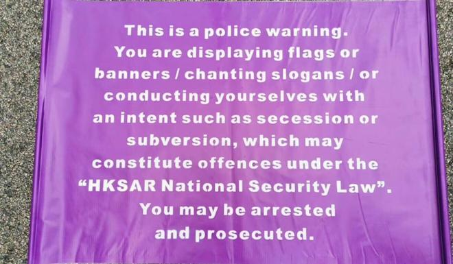 Police have made a new flag warning against behaviour that could break the new national security law. Photo: Handout