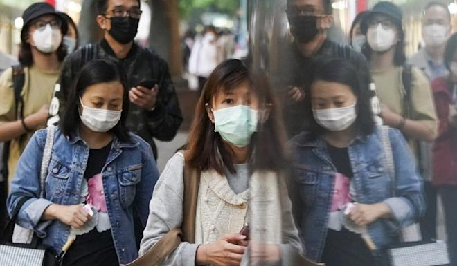 Pedestrians wearing face masks in Tsim Sha Tsui. Hong Kong is familiar with mask-wearing after the city was plagued by the Sars outbreak in 2003. Photo: Felix Wong