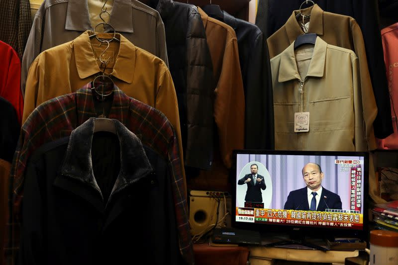 Nationalist Kuomintang Party (KMT) candidate Han Kuo-yu is seen on a TV screen during the third live policy address ahead of January's election, in Tainan