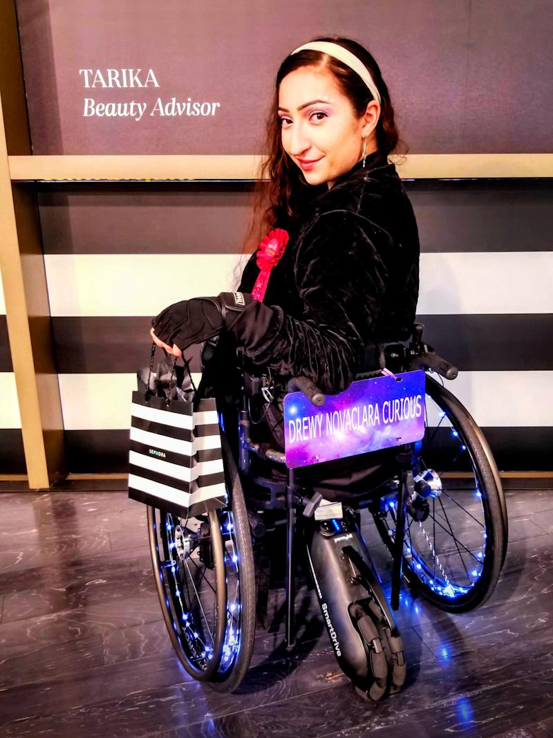 The model and actress pictured with her lit-up wheelchair, which she has named Opal. Doctors told her she was 'too young' to have a stroke.