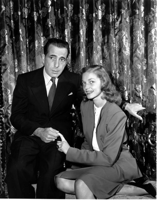 FILE - This May 1945 file photo shows actor Humphrey Bogart, left, with his wife actress Lauren Bacall. Bacall, the sultry-voiced actress and Humphrey Bogart's partner off and on the screen, died Tuesday, Aug. 12, 2014 in New York. She was 89. (AP Photo, File)