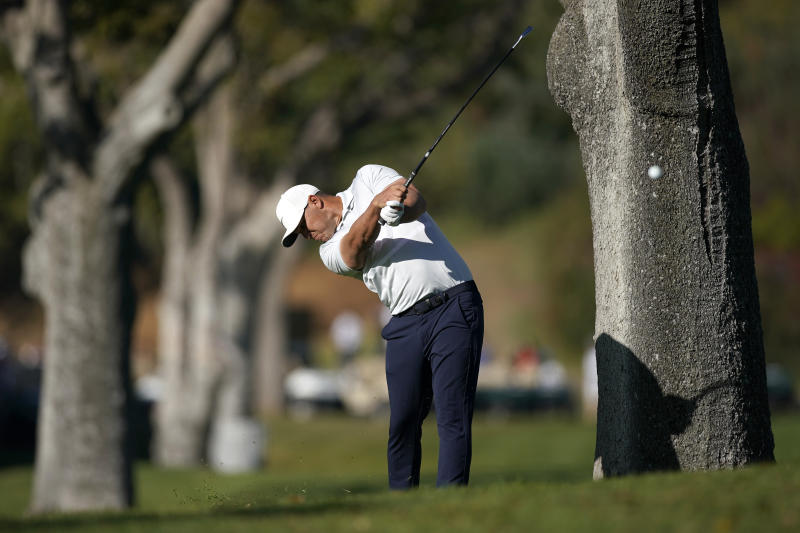 Brooks Koepka hits his second shot from the rough on the first hole during the final round of the Genesis Invitational golf tournament at Riviera Country Club, Sunday, Feb. 16, 2020, in the Pacific Palisades area of Los Angeles. (AP Photo/Ryan Kang)