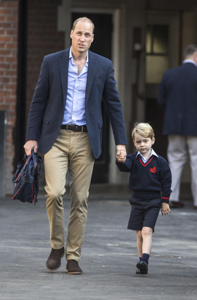 Prince George arrives for his first day at Thomas's Battersea in 2017, with his father William. [Photo: PA]