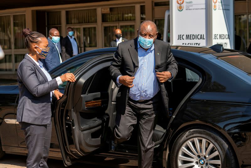 FILE PHOTO: South African President Cyril Ramaphosa visits the coronavirus disease (COVID-19) treatment facilities in Johannesburg