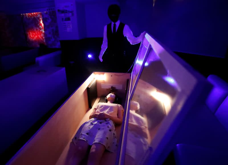 COVID-19 scary? Japan group offers coffins, chainsaws for stress relief