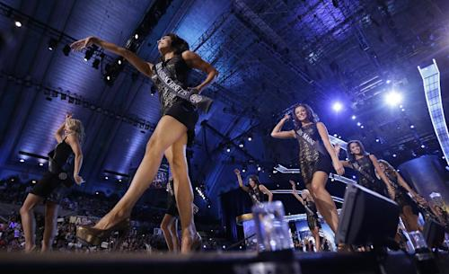 Contestants walk on the runway during the Miss America 2014 pageant, Sunday, Sept. 15, 2013, in Atlantic City, N.J. (AP Photo/Julio Cortez)