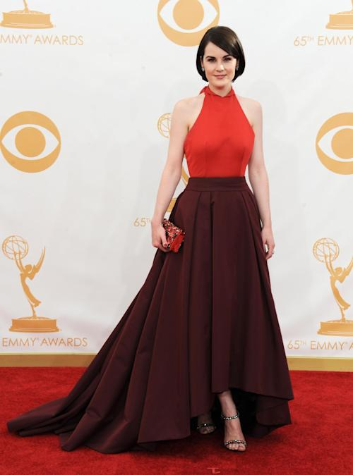 Michelle Dockery arrives at the 65th Primetime Emmy Awards at Nokia Theatre on Sunday Sept. 22, 2013, in Los Angeles. (Photo by Jordan Strauss/Invision/AP)