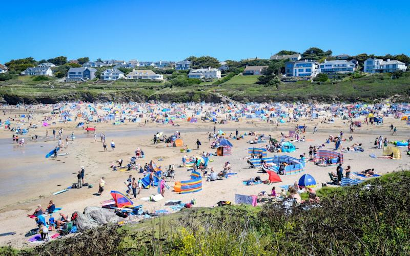 Tourists enjoying the beach on July 30 in Polzeath, UK - Finnbarr Webster/Getty Images Europe