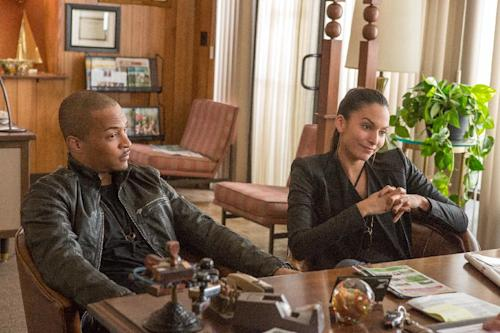 "This undated publicity image released by Universal Pictures shows T.I, left, and Genesis Rodriguez in a scene from, ""Identity Thief."" (AP Photo/Universal Pictures)"
